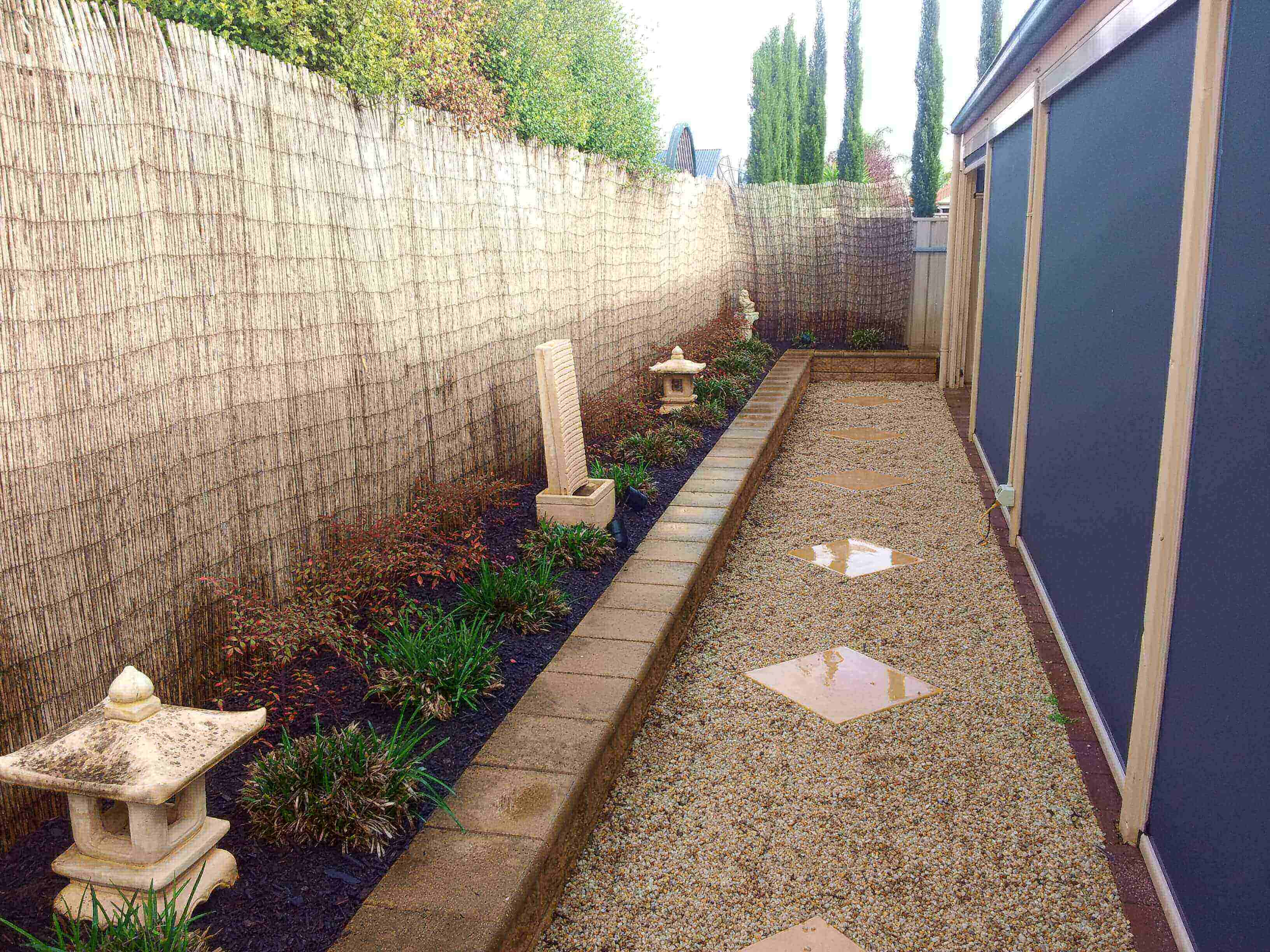 Landscaping tiny stretches of available backyard-why wait for a big lawn to have water feature when you can have it in your own compact backyard