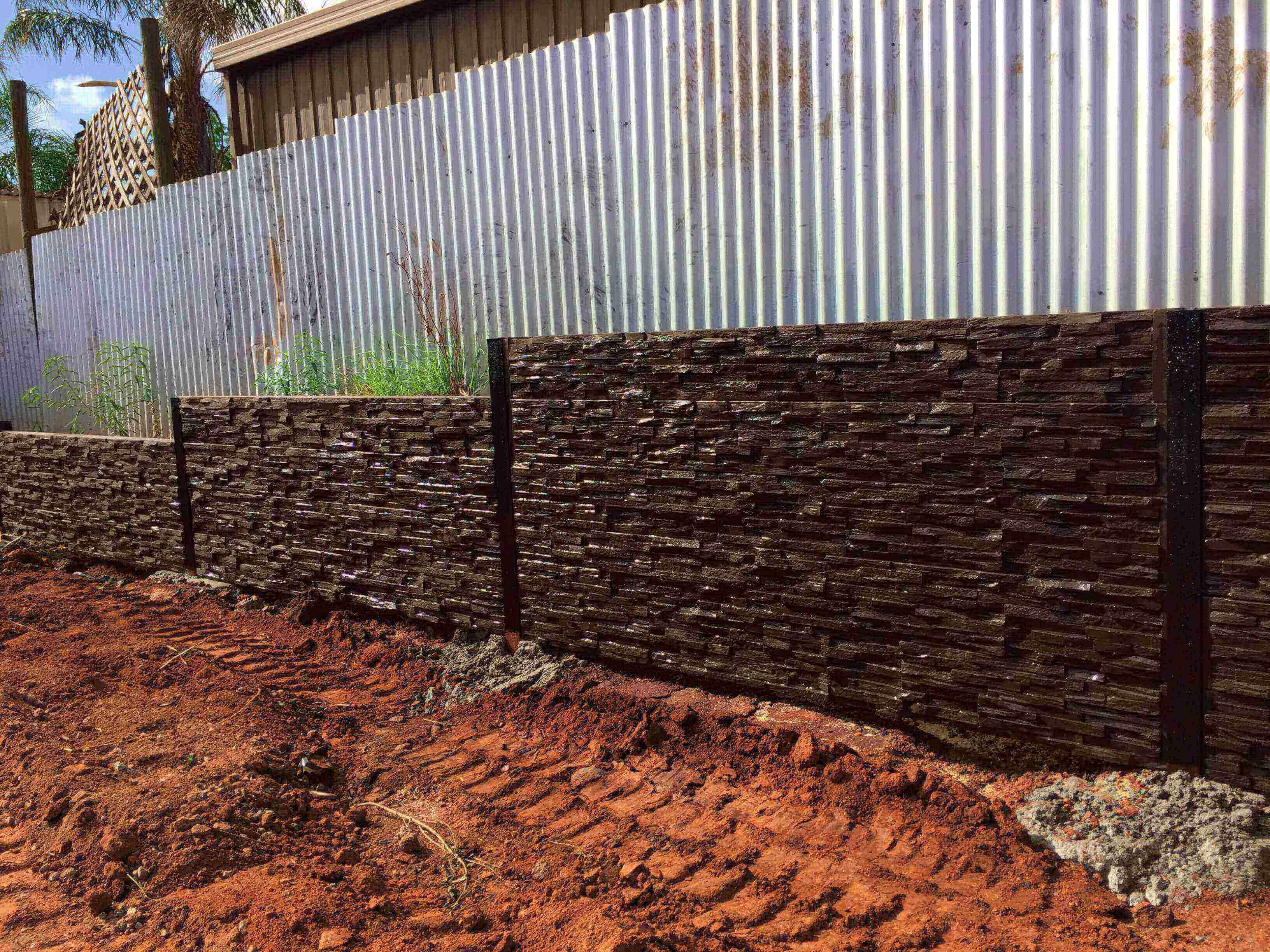 We can add a textured look to your retaining wall