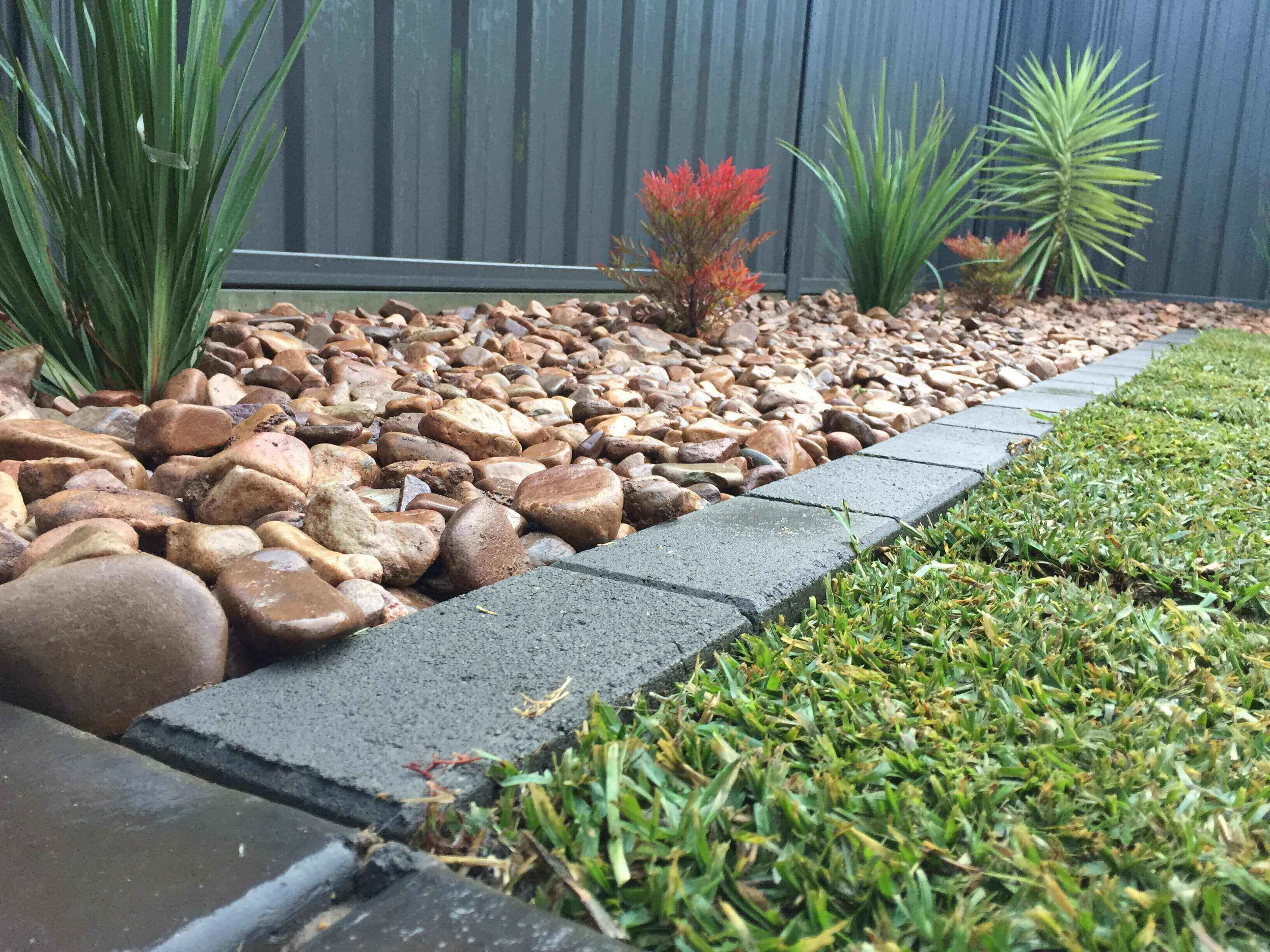North Gate - Creating a plant bed decked with stones and a walking concrete pavement in our client's backyard