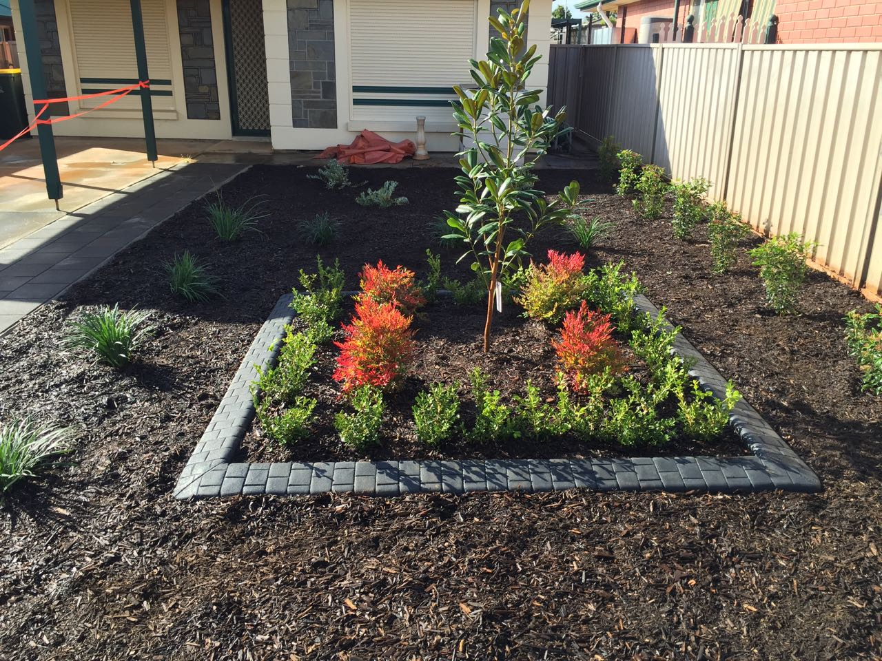 Craigmore - Beautifully Landscaped Front Yard With Leaf Mulch