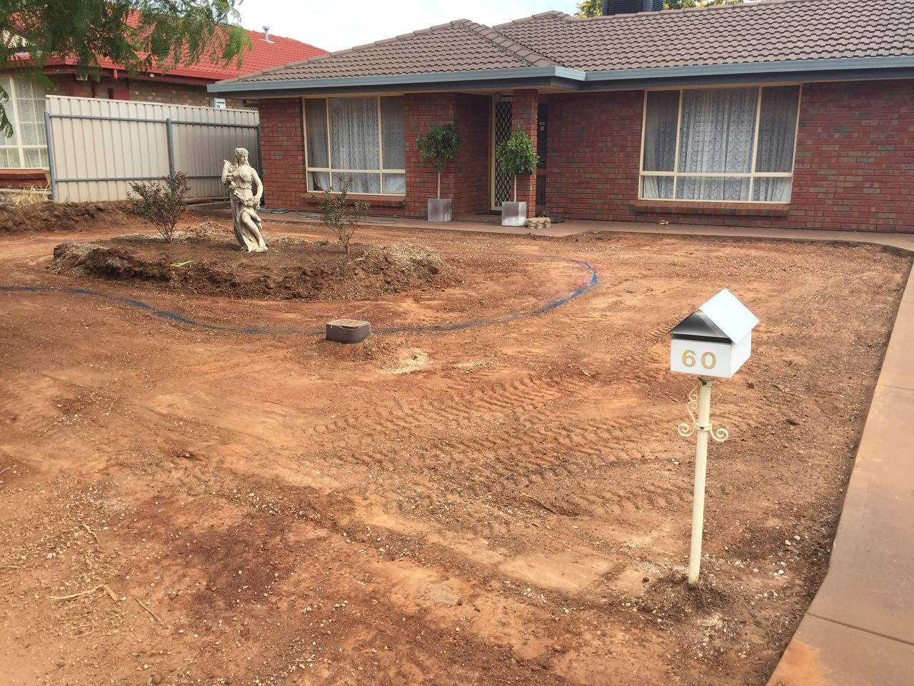 Craigmore - Installing Light & Water Feature With Retaining Wall